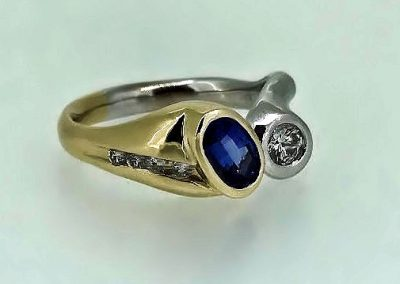 Sleek Saphire and Diamond 2 tone bezel  ring