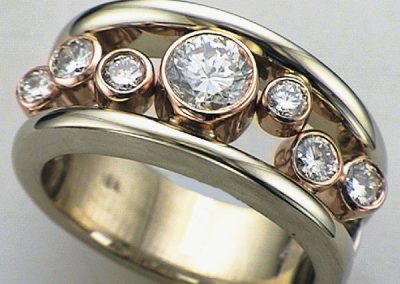 Contemporary staggered diamonds in rosegold bezels