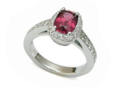 Cushion cut Rhodolite with diamond halo ring