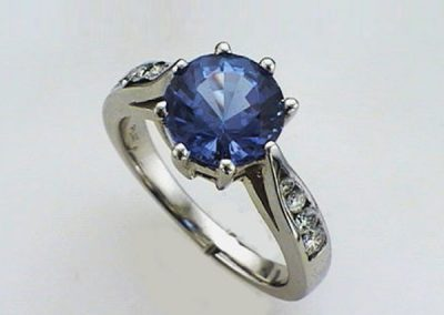 Extraordinary Tanzanite in cathedral  14KWG ring