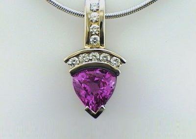 Pretty pink saphire pendant with diamonds