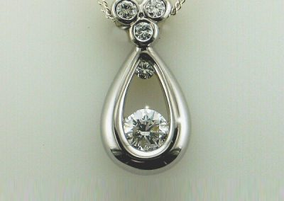 Stunning tear drop motif diamond pendant