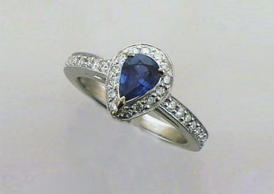 Traditional Blue Sapphire with pear shape motif diamond halo ring