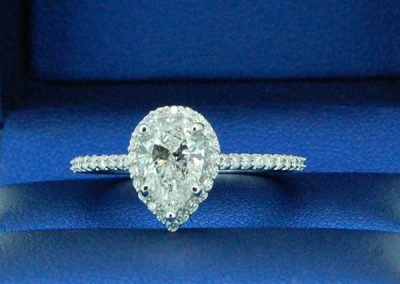Lovely Pear Center Halo with Round Diamond Shank